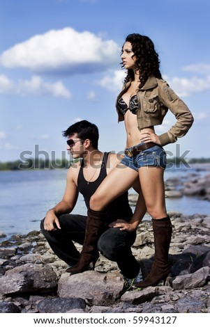 sexy fashion couple outside  by the lake - stock photo