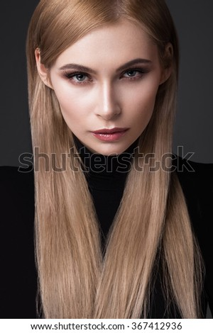 sexy fashion model with long hair, young European attractive, beautiful eyes, perfect skin is posing in studio for glamour vogue test photo shoot showing different poses. Picture taken in the studio - stock photo