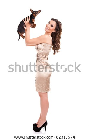 sexy, fashion woman plying with  her little puppy, miniature  pincher, isolated on white - stock photo