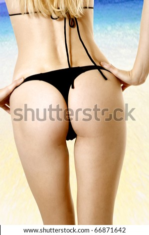 Sexy female body on beach. Perfect woman with ideal buttocks close up. Concept: sea, health, diet, fitness; skin; carefull; rest; - stock photo