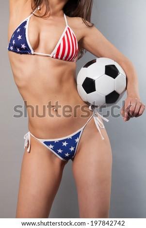 sexy female in american bikini holding a soccer ball  - stock photo