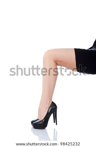 sexy female legs in classical shoes on a heel isolated over white background - stock photo