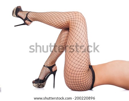 Sexy female legs in net stockings isolated over white - stock photo
