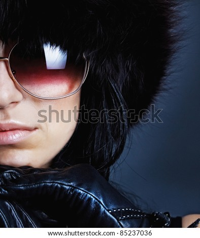 Sexy female wearing leather gloves and sunglasses - stock photo
