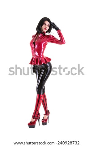 Sexy fetish woman dressed in black and red latex outfit, isolated on white background  - stock photo