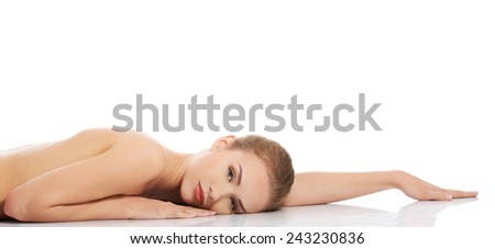Sexy fit naked woman lying on belly. - stock photo