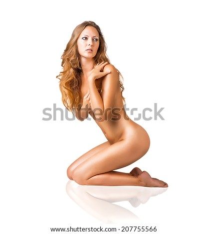 Sexy fit naked woman with healthy clean skin and beautiful long hair sitting, isolated on white  - stock photo