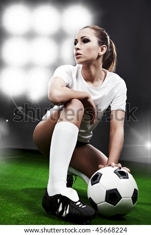 Sexy football  player on stadium - stock photo