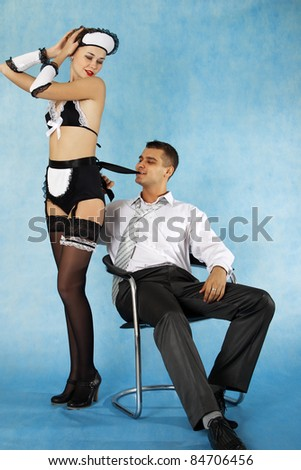 Sexy game of business man and his maid - stock photo