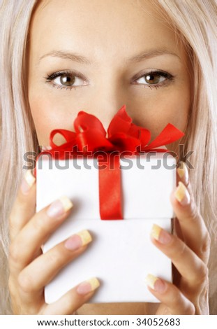 sexy girl holding a gift in packing - stock photo