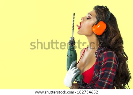 sexy girl holding a power drill - stock photo