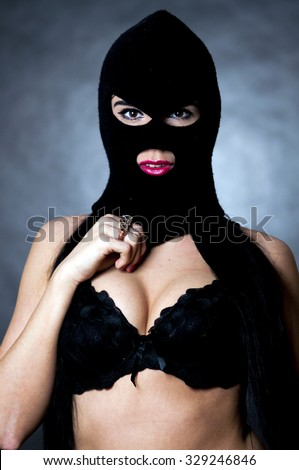 sexy girl in balaclava - crime and violence - stock photo