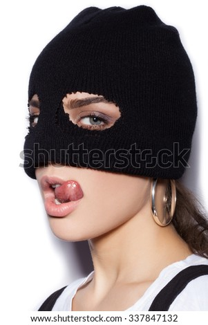 sexy girl in balaclava - crime and violence on white background not isolated - stock photo