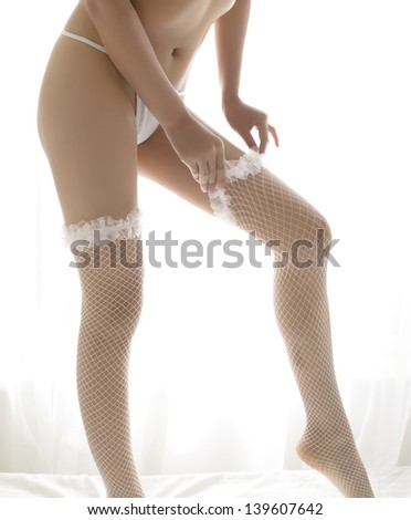 Sexy Girl In bedroom - stock photo