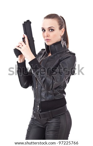 Sexy girl in black clothes with gun - stock photo