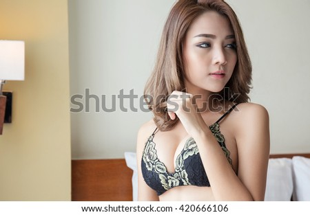 Sexy girl in lace lingerie posing in bedroom - stock photo
