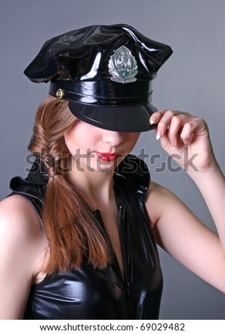 Sexy girl in police uniform - stock photo