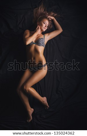 sexy girl in underwear  on the silk bed - stock photo
