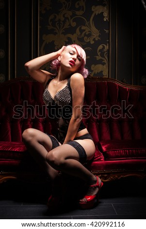 Sexy girl in underwear with many thorns - stock photo
