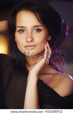 sexy girl on blurred  colorful  background in studio