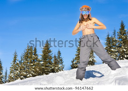 Sexy girl on ski vacation - stock photo