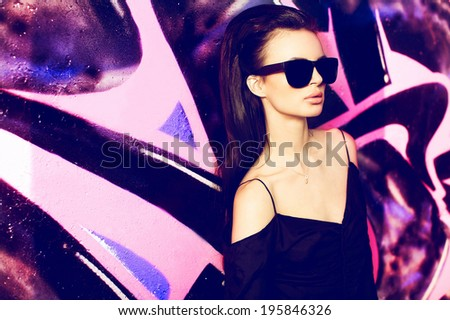 sexy girl outdoor summer fashion portrait. yong beautiful female model in glasse , black t-shirt in extreme park - stock photo