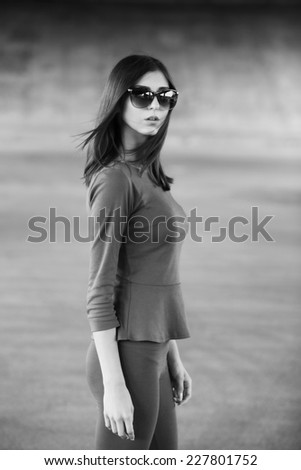 Sexy girl outdoors. Monochrome image - stock photo