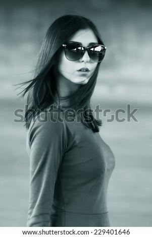 Sexy girl outdoors. Monochrome image - stock photo