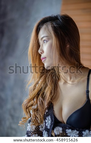sexy girl poses in the bed room - stock photo
