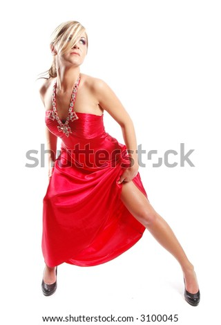 sexy girl posing for fashion photo in a red dress