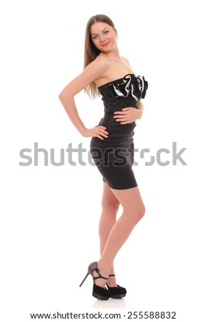 sexy girl posing in a black dress isolated over white background