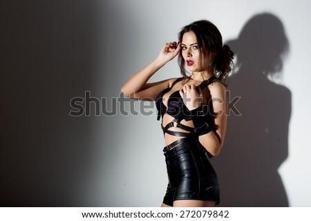 sexy girl posing in black lingerie studio dark background - stock photo