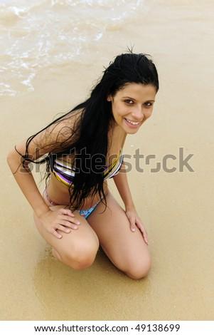 sexy girl posing on the beach - stock photo