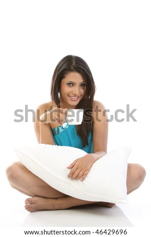 Sexy girl relaxing with cup of coffee - stock photo