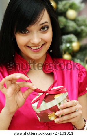 sexy girl smiles and holding a gift in packing