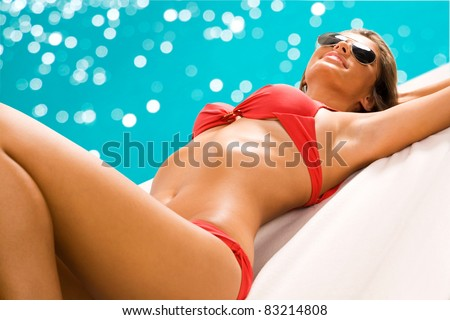 Sexy girl sunbathing on the beach - stock photo