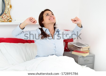 Sexy girl wakes up in bed - stock photo