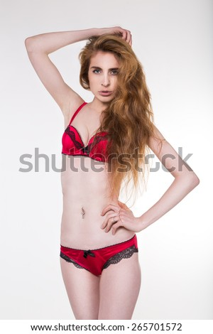 Sexy  girl  wearing a red bikini giving a seductive look - stock photo