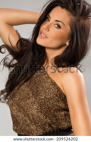 Sexy girl wearing leopard fur - stock photo