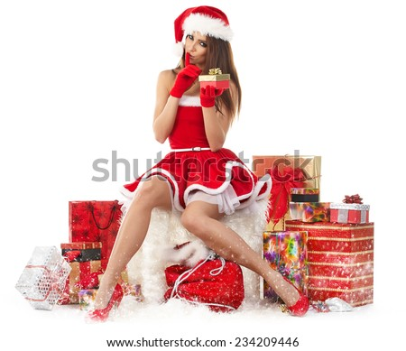 Sexy girl wearing santa claus clothes with gifts - stock photo