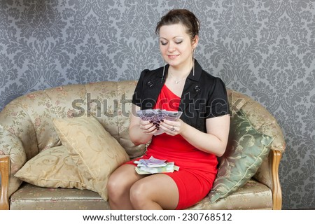 sexy girl with wads of 500 euros - stock photo