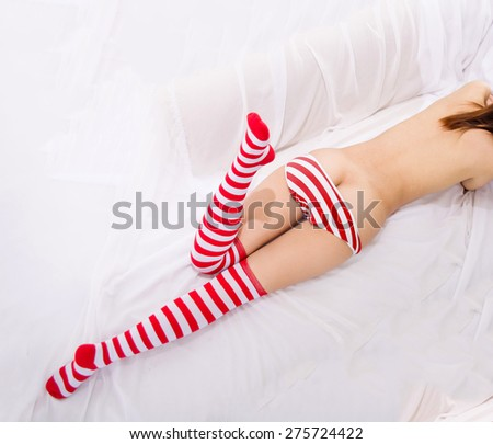 sexy girl woman in red white streak panties of the body part Christmas - stock photo