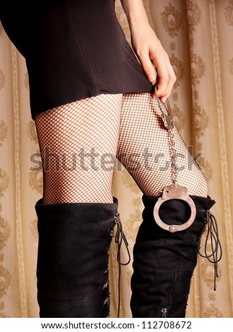Sexy girls in stockings holds handcuffs - stock photo