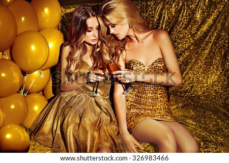 Sexy girls on lounge. Celebrating. - stock photo