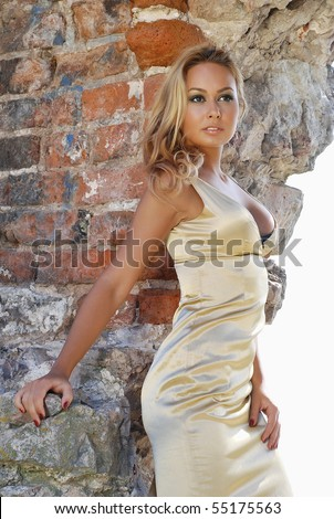 Sexy gorgeous young woman near old wall - stock photo