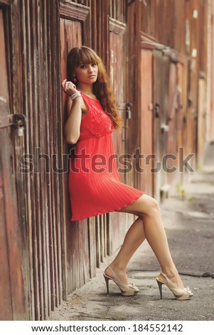 Sexy gorgeous young woman near old wooden wall - stock photo