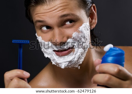 Sexy handsome young man shaving