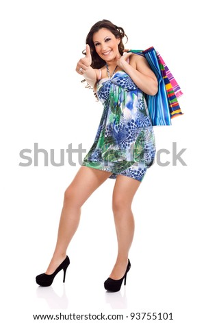 sexy, happy shopping girl, showing thrum up, isolated on white background - stock photo