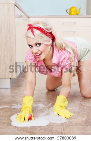 Sexy housewife cleaning the floor, similar available in my portfolio - stock photo