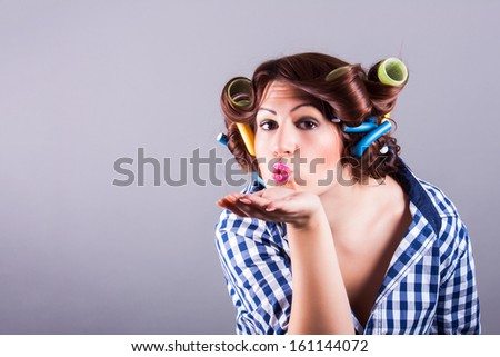 sexy housewife with curlers. pin up portrait - stock photo